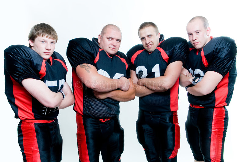 Riga dei giocatori di football americano immagini stock