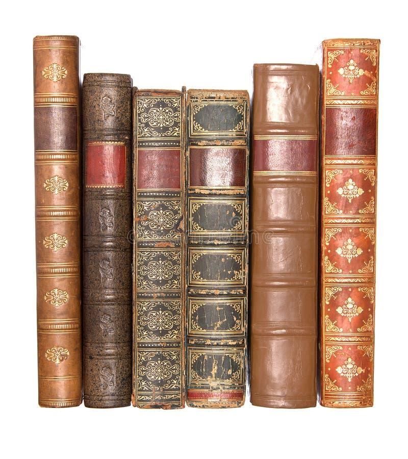 Riga di vecchi libri rilegati di cuoio fotografia stock