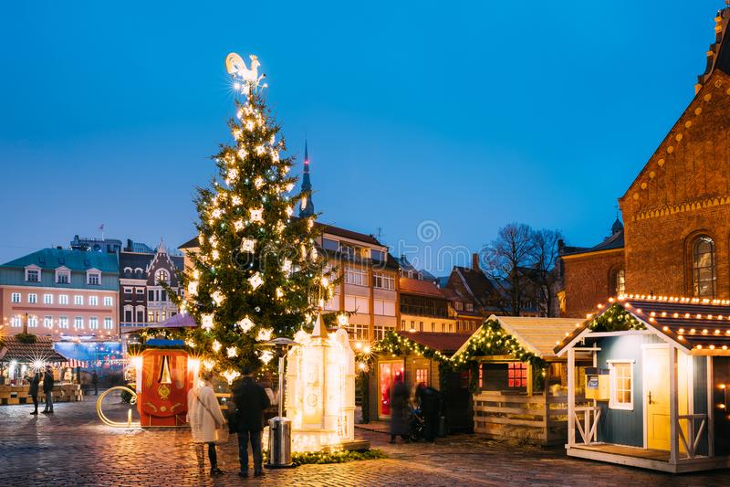 Riga, Latvia. Christmas Market On Dome Square. Christmas Tree And Trading Houses stock photography
