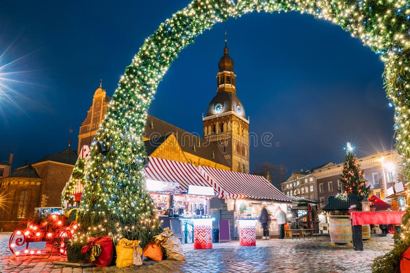 Riga, Latvia. Christmas Market On Dome Square With Riga Dome Cathedral. Christmas Tree And Trading Houses. Famous royalty free stock image