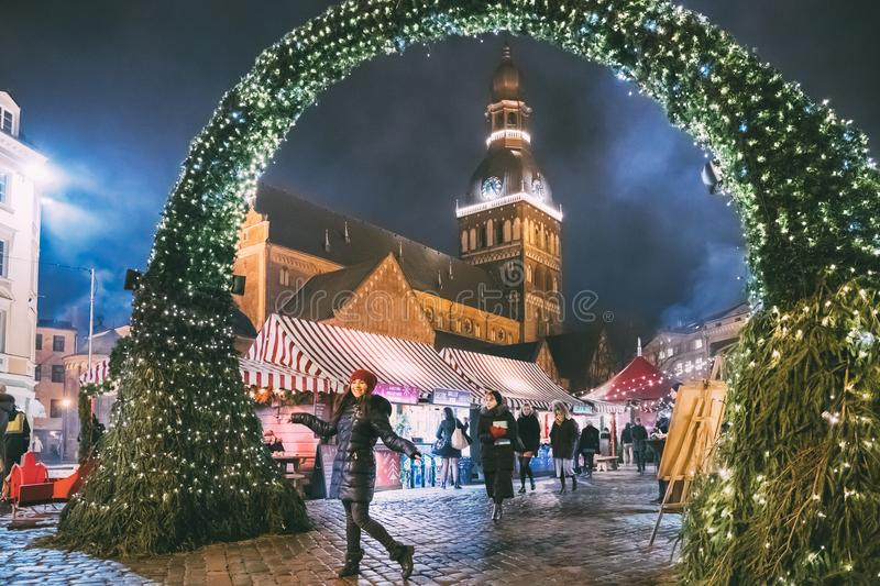 Riga, Latvia - December 18, 2017: People Walking Near Traditional Christmas Market On Dome Square With Riga Dome stock image