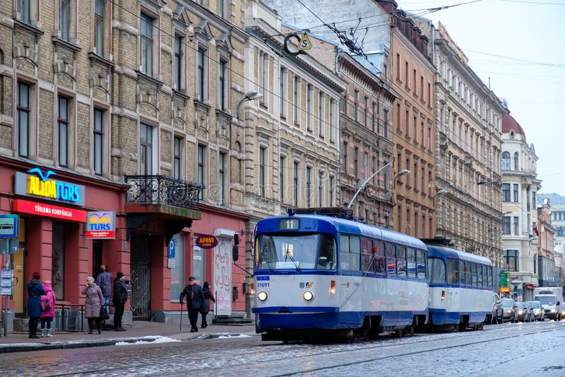 Riga / Latvia - 02 December 2019: Tram at old town Riga street. Public transport in Riga, Latvia stock images