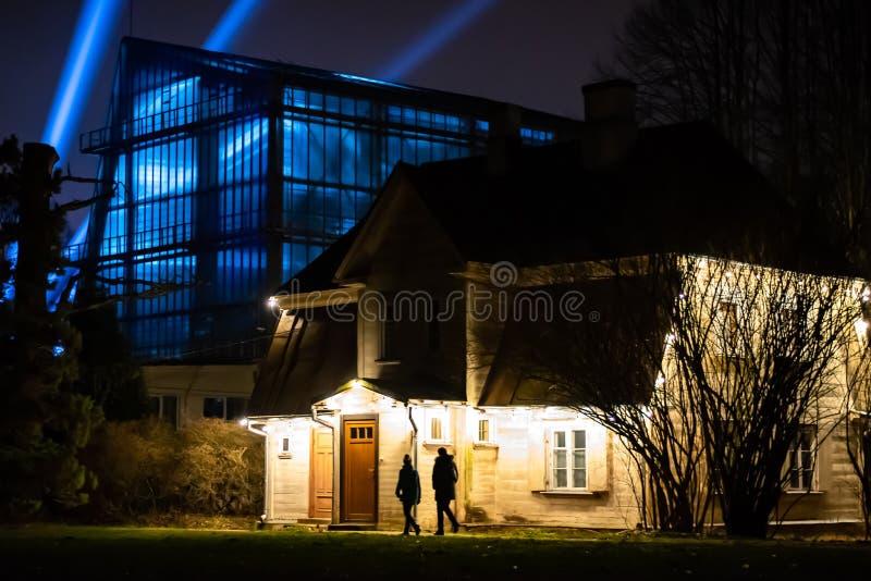 A house illuminated by white lights. Riga, Latvia - Garden of winter lights, light installations, a house illuminated by white lights and a building decorated stock photography
