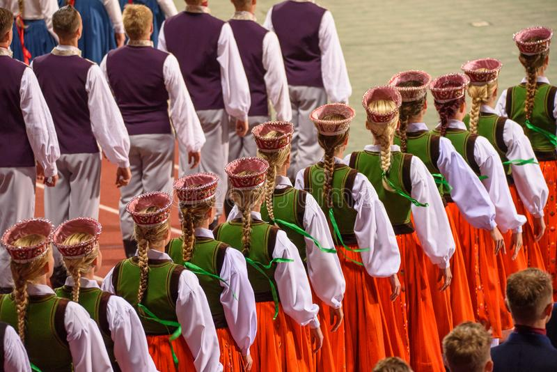 Folk dancers, during The Song and Dance Celebration in Riga, Latvia. 07.07.2018. RIGA, LATVIA. Great Dance Concert `Mara's Country`, during The Song and royalty free stock photo