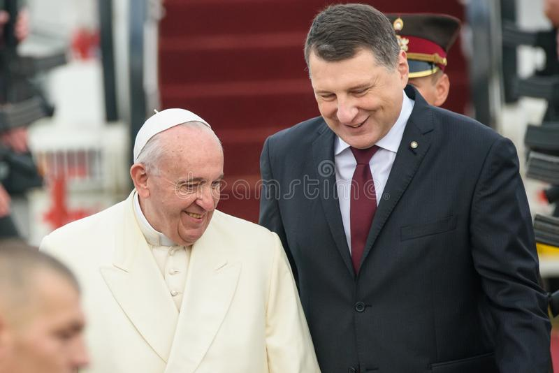 His Holiness Pope Francis and Raimonds Vejonis, President of Latvia. 24.09.2018. RIGA, LATVIA. His Holiness Pope Francis arriving at Riga International Airport royalty free stock image