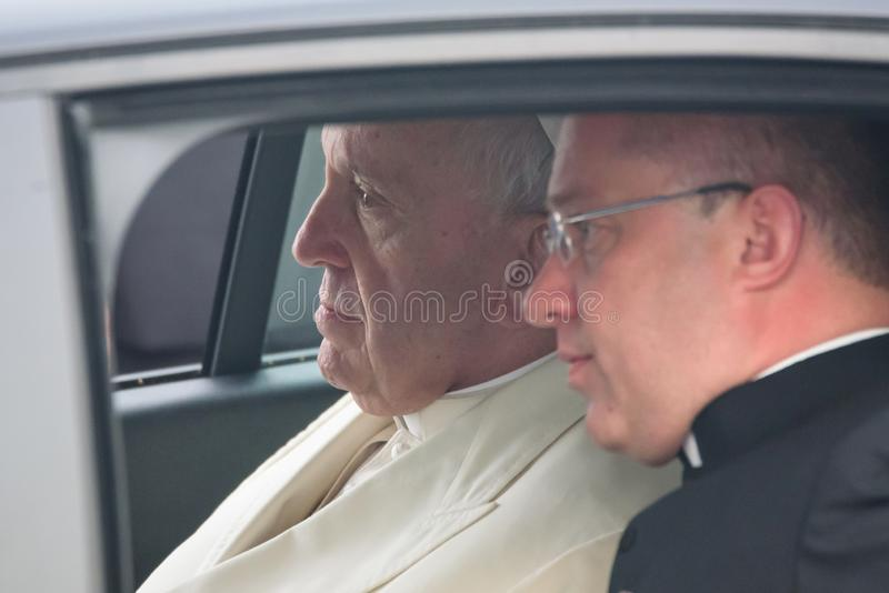 His Holiness Pope Francis sitting at car. 24.09.2018. RIGA, LATVIA. His Holiness Pope Francis arriving at Riga International Airport stock photos