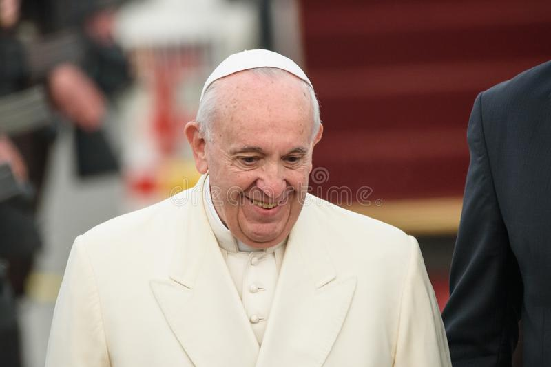 His Holiness Pope Francis smiling, during arrival in Riga. 24.09.2018. RIGA, LATVIA. His Holiness Pope Francis arriving at Riga International Airport royalty free stock image