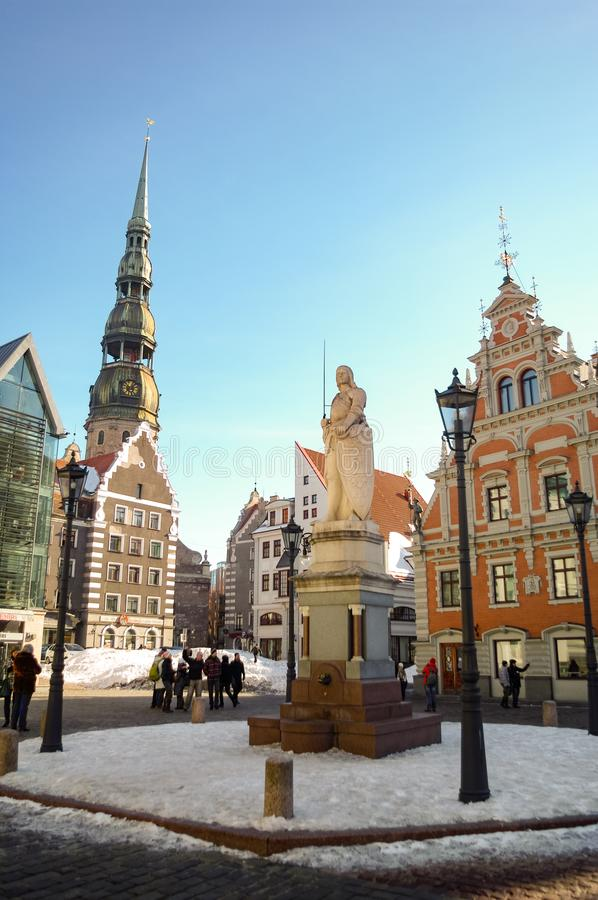 City Hall Square with House of the Blackheads and Saint Peter church in Old Town of Riga, Latvia royalty free stock images