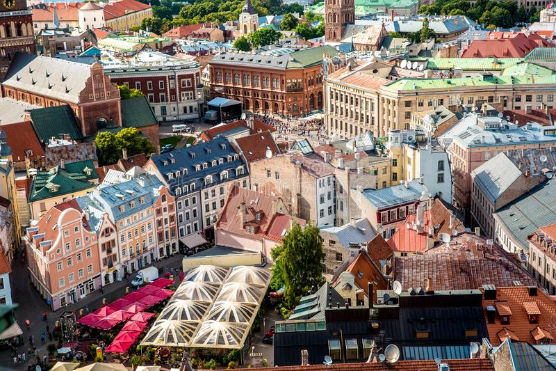 Central old town squre with toursits in Riga city, Latvia. Riga, Latvia - July, 2017: Central old town squre with toursits in Riga city, Latvia stock photography