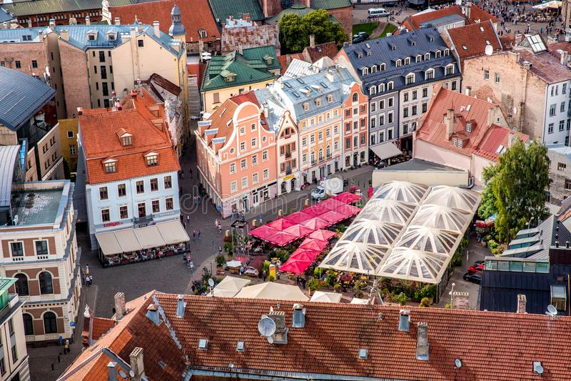 Central old town squre with toursits in Riga city, Latvia. Riga, Latvia - July, 2017: Central old town squre with toursits in Riga city, Latvia royalty free stock image