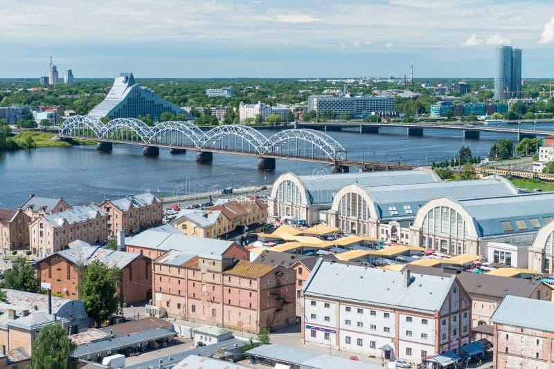 RIGA, LATVIA - JULY 7, 2017: Panoramic aerial city view of market. Riga attracts 2 million tourists annually stock photo
