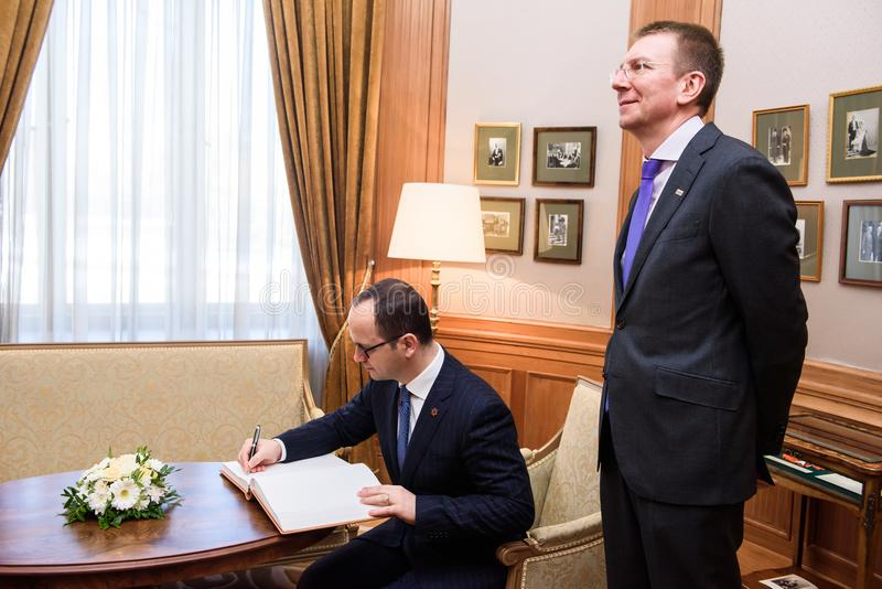 Lbanian minister of Foreign Affairs Ditmir Bushati signs at guest book. stock photo
