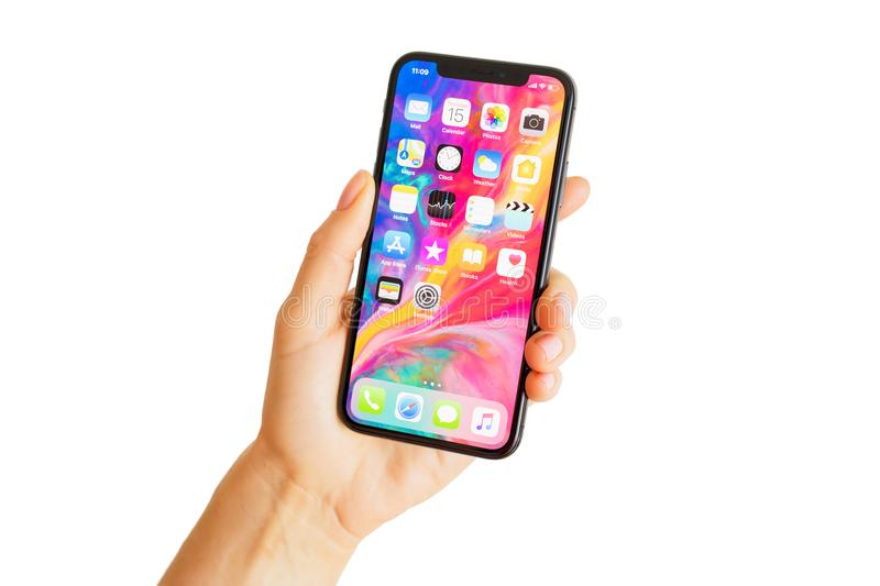 Riga, Latvia - March 15, 2018: Close up photo of latest generation iPhone X in person`s hand. royalty free stock photo