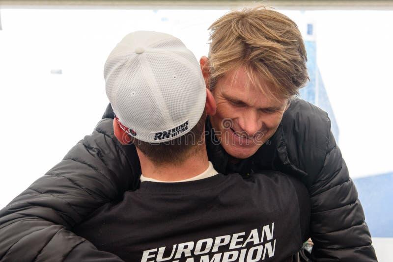 Marcus Gronholm congratulates Reinis Nitiss with European Champion for EURO Supercar. 16.09.2018. RIGA, LATVIA.Marcus Gronholm congratulates Reinis Nitiss with royalty free stock photo