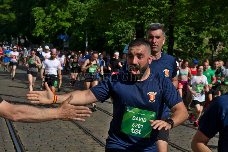 Riga, Latvia - May 19 2019: Spanish bearded man thrilled to give high five for spectators stock images