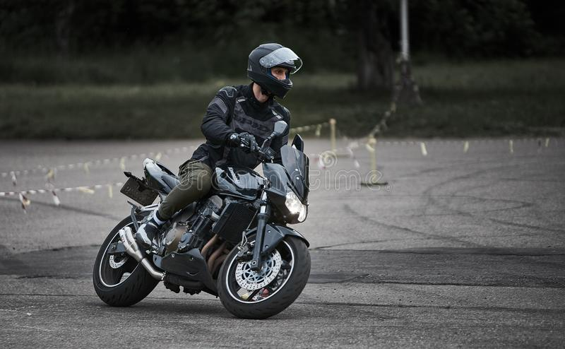 Riga, Latvia - 16.06.2019 Motorcycle gymkhana sport. A biker on a motorcycle. Motorcycling. Open moto fest royalty free stock images