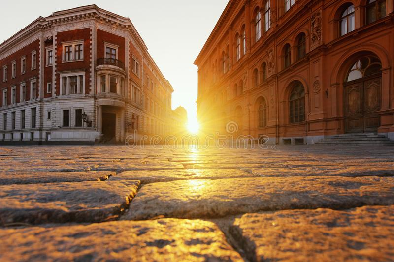 Riga, Latvia, April 20, 2019 - View of the sunset on the square in the center of Old Riga royalty free stock image