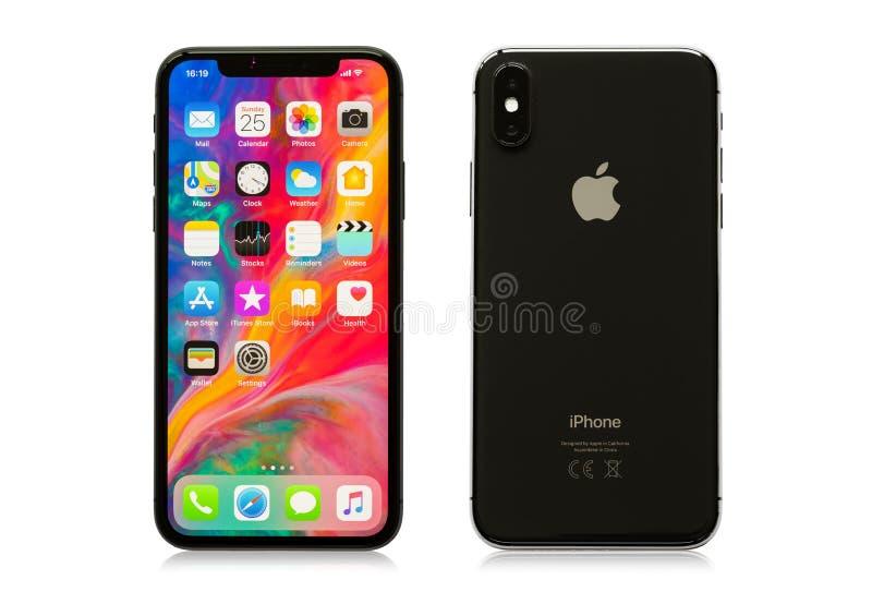 Riga, Letonia - 25 de marzo de 2018: El último iPhone X de la generación en los lados blancos del fondo, delanteros y traseros fotografía de archivo libre de regalías