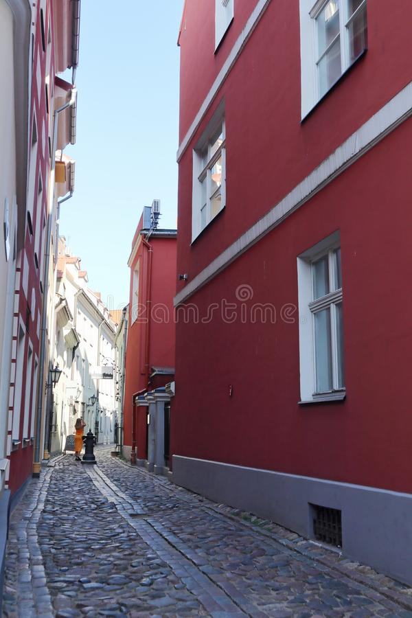 Riga old city center streets view traveling europe urban architecture town with red colorful walls stock photos