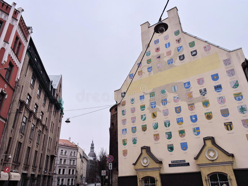 Riga town, Latvia. Old house with Latvia country region arms painted on wall stock photography