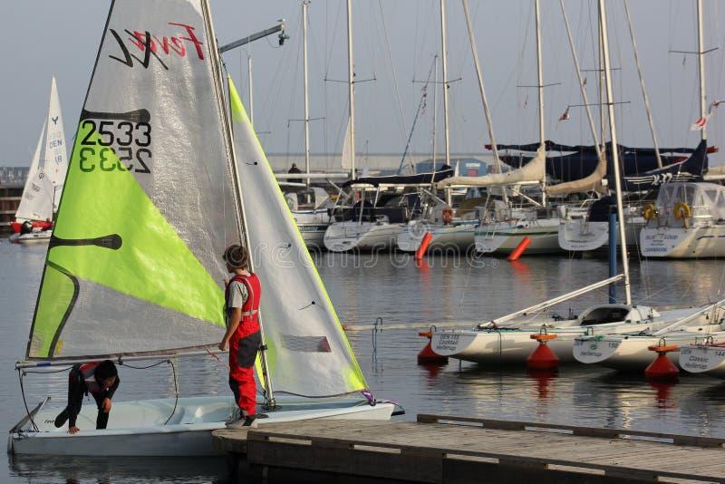 Rigging feva sailboat in harbor royalty free stock photo