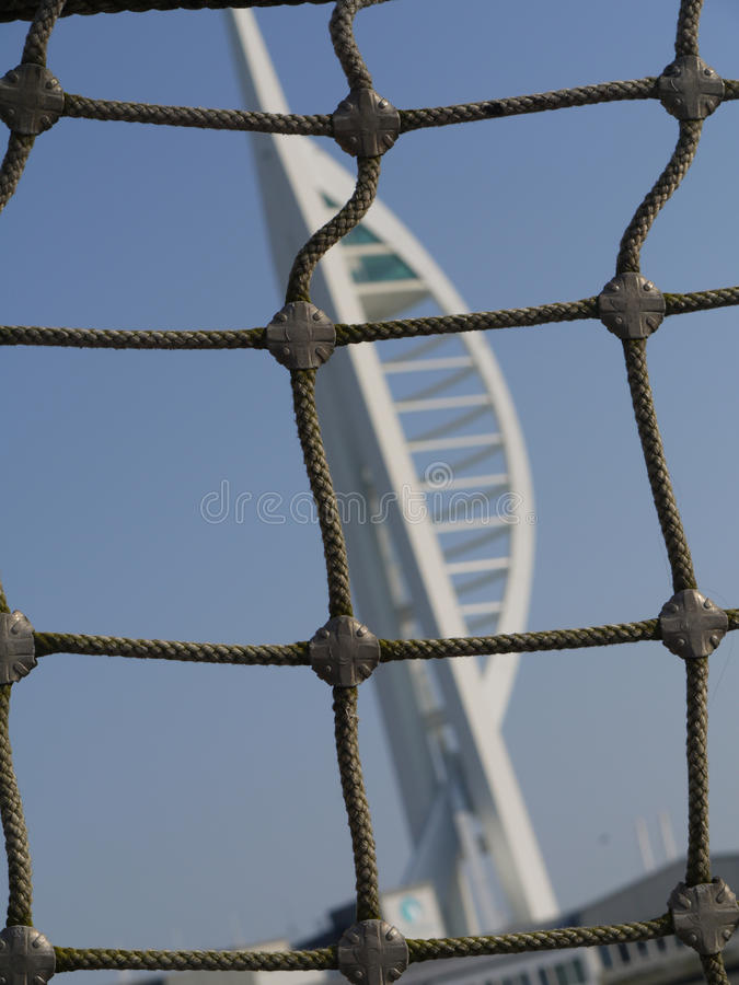 Rigging of ship with The Spinnaka tower backdrop in Portsmouth, Hampshire. Old and new stock photos