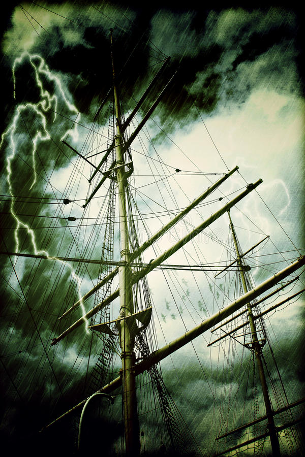 Rigging of a tall sailing ship in rain and thunderstorm. With greenish clouds royalty free stock photography