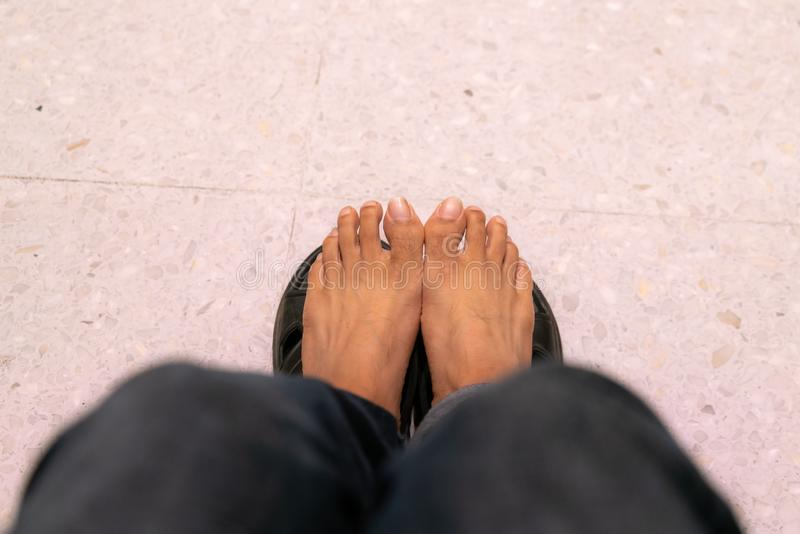 Right foot and long pants jean stock photography
