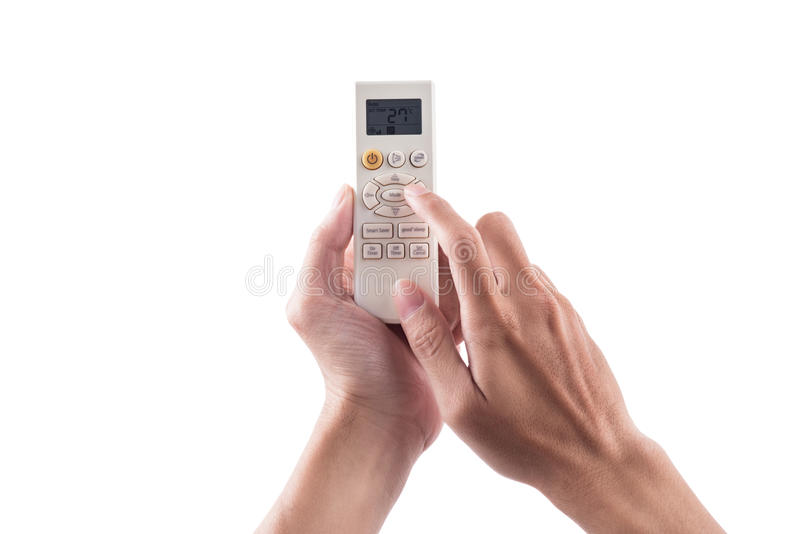 Right hand holding remote air conditioner turn up to 27 celcius. With air conditioner royalty free stock image