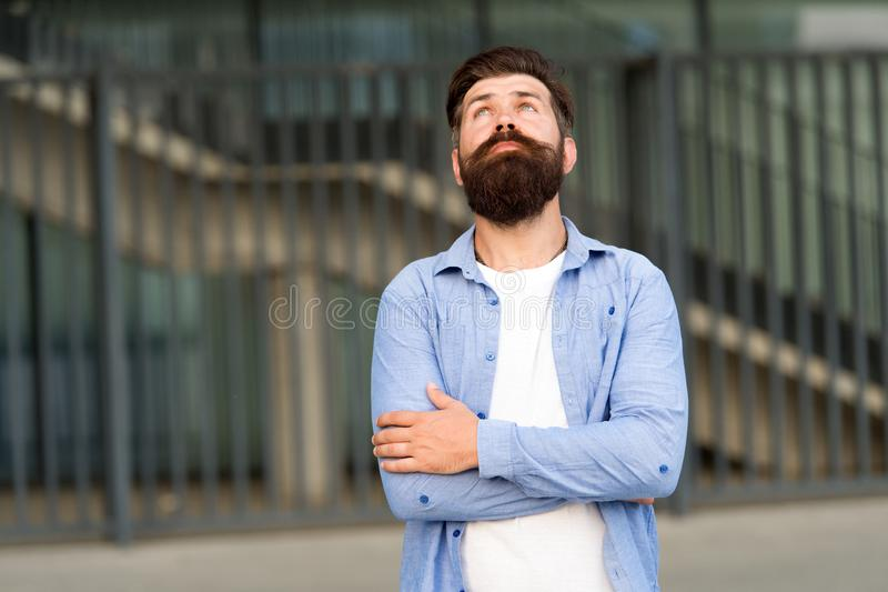 Right here and now. What is on his mind. Pensive hipster thinking pleasant thoughts. Man bearded hipster urban royalty free stock image