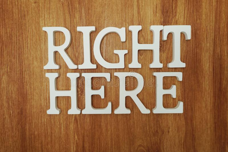 Right Here Word alphabet letters on wooden background royalty free stock images
