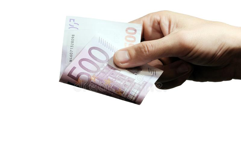 The right male hand gives five hundred euros. Concept of sale and purchase, discounts and rates, business profits. Background for royalty free stock image