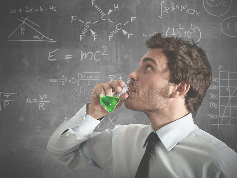 The right potion for success. A businessman drinking the right potion for success royalty free stock photos