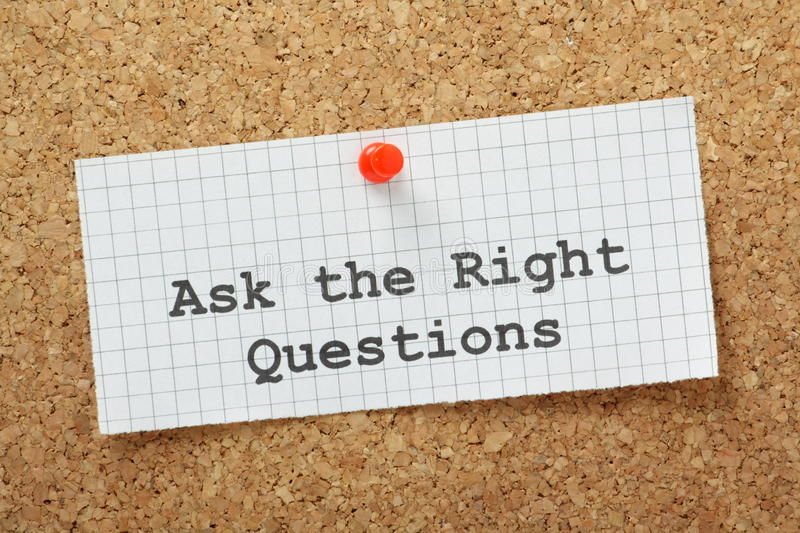 The Right Questions. Ask The Right Questions typed on a piece of graph paper and pinned to a cork notice boards. This is essential to make an impression at stock images