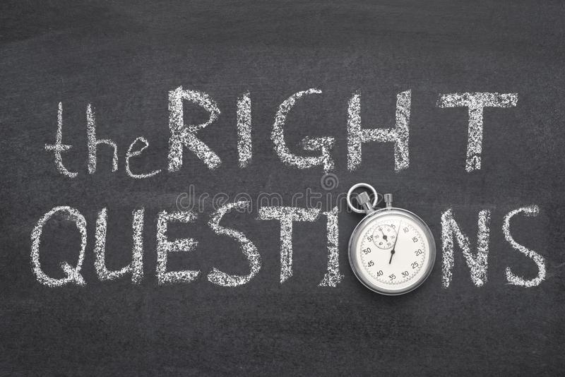 The right questions watch. The right questions phrase handwritten on chalkboard with vintage precise stopwatch used instead of O royalty free stock image