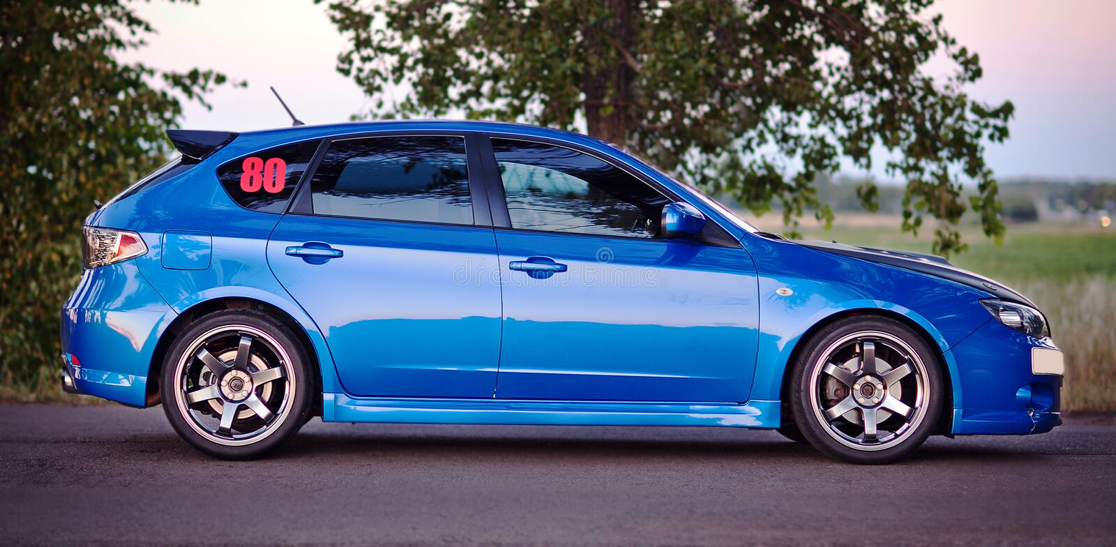 Right side view of blue sport car.  stock images