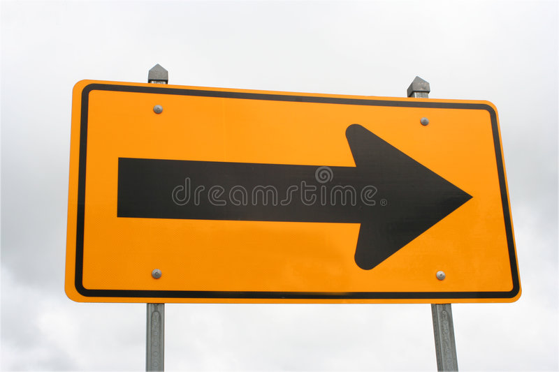 Right sign (traffic). Right sign against the cloudy sky stock photography