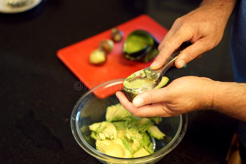 The right tool makes preparing avocados easy stock photos