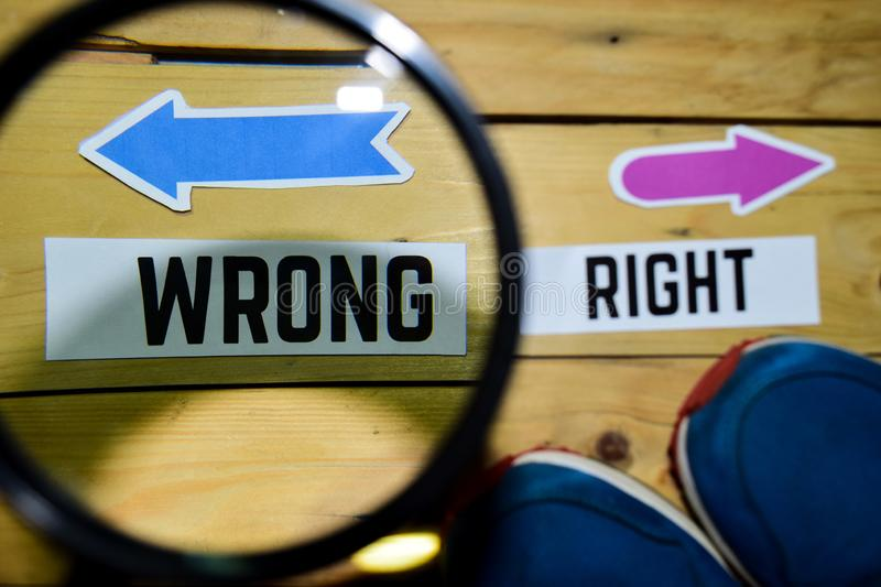 Right or Wrong opposite direction signs with sneakers and eyeglasses on wooden. Vintage background. Business and education concepts stock image