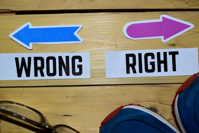 Right or Wrong opposite direction signs with sneakers and eyeglasses on wooden vintage background. Business and education concepts royalty free stock photography