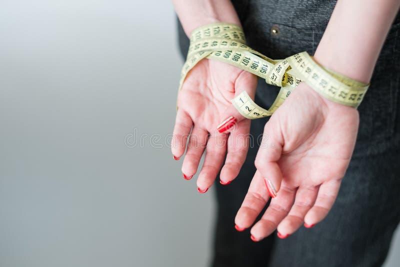 Rigid diet fasting slimming self control hands stock photo