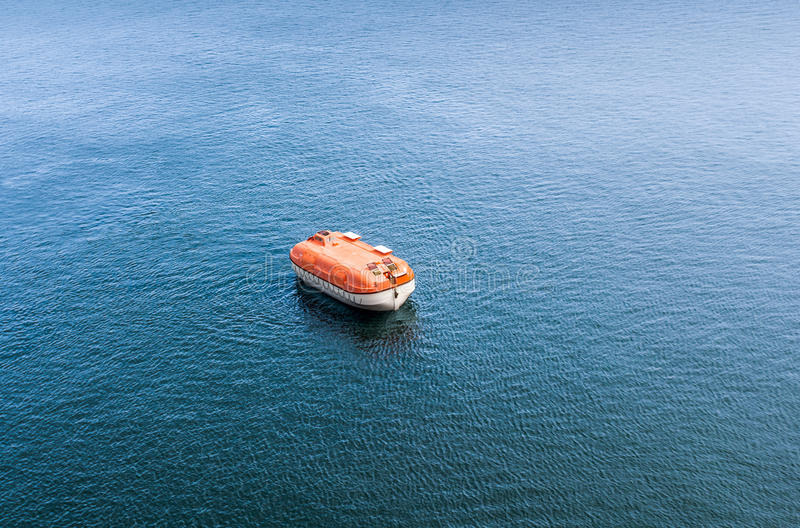 Rigid lifeboat during rescue excesizes alone in the sea royalty free stock images