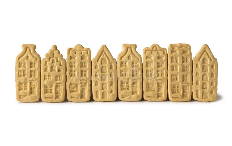 Rij van boterkoekjes in de vorm van Nederlandse kanaalhuizen royalty-vrije stock afbeeldingen