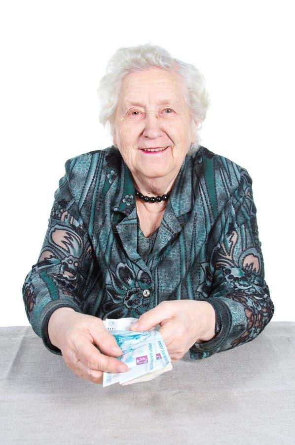 Rijke Oma met geld. stock foto
