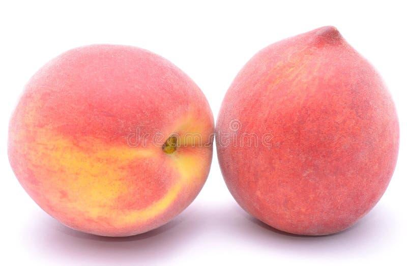 Rijp die perzikfruit op witte achtergrond wordt geïsoleerd royalty-vrije stock foto