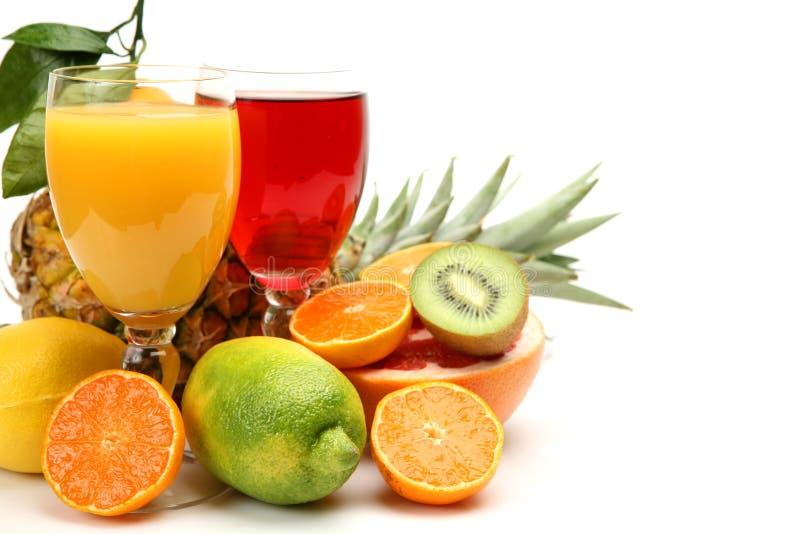 Rijp fruit en sap stock afbeelding