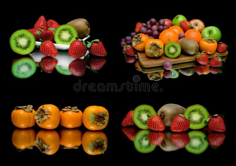 Rijp sappig fruit op een zwarte achtergrond stock afbeeldingen