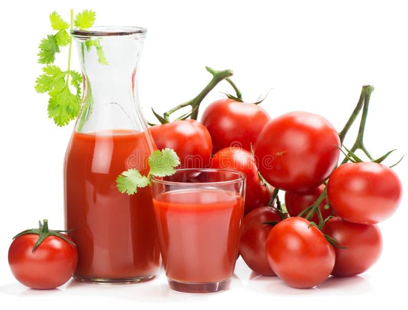 Rijp tomaten en tomatesap royalty-vrije stock foto's