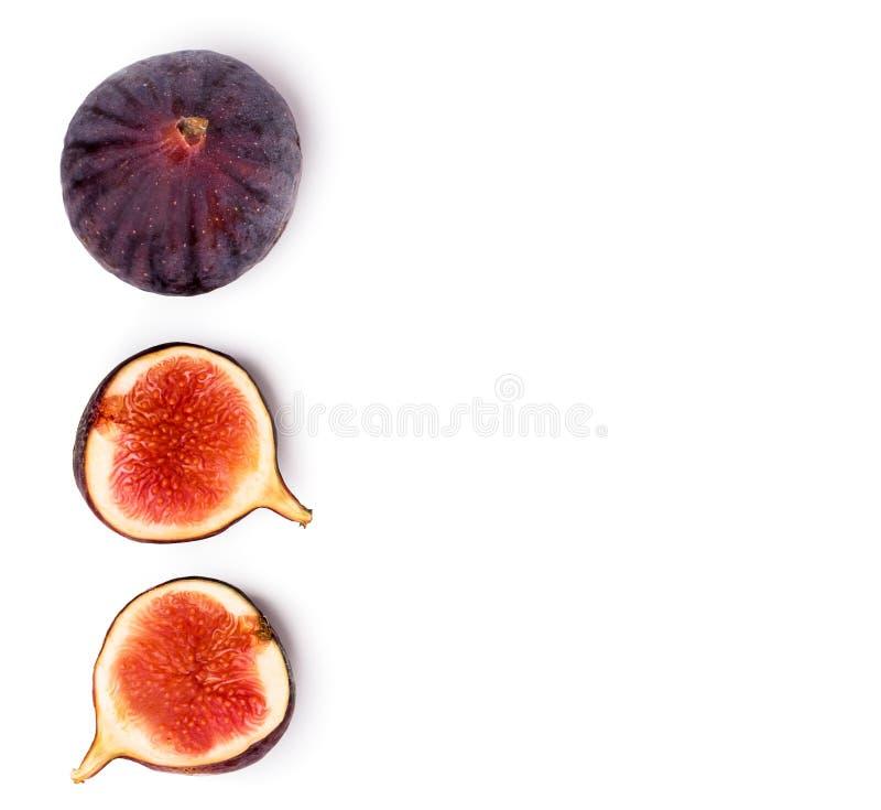Rijpe fig. en de twee helften op een wit De mening vanaf de bovenkant royalty-vrije stock afbeeldingen