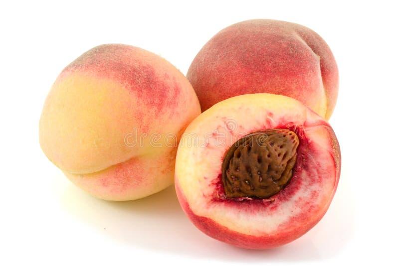 Rijpe, gele perziken. stock fotografie